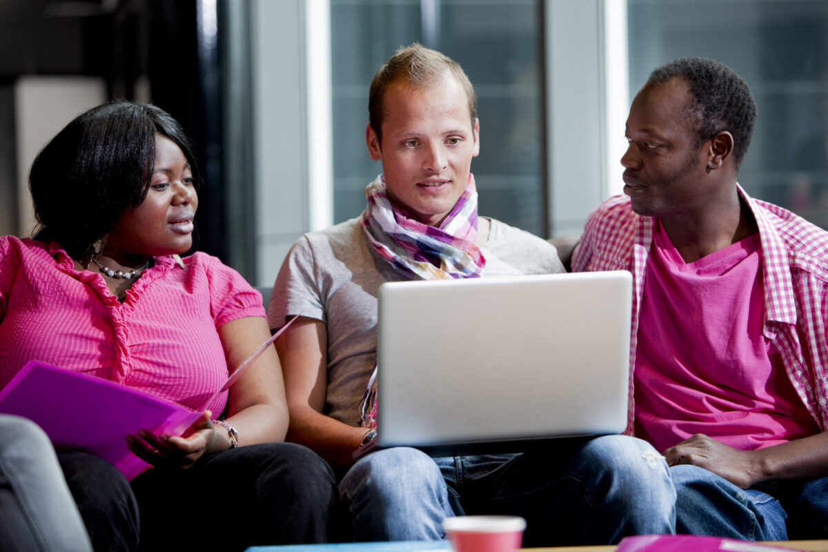 Students sitting in a lobby.